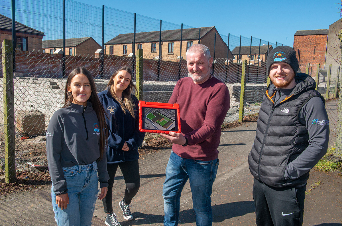 Pictured demonstrating the new app is Paul Smyth from Belfast Interface Project (centre) alongside Caitriona O'Neill, Eimear Kelly and Kevin Barry Brown from the Star Neighbourhood Centre.