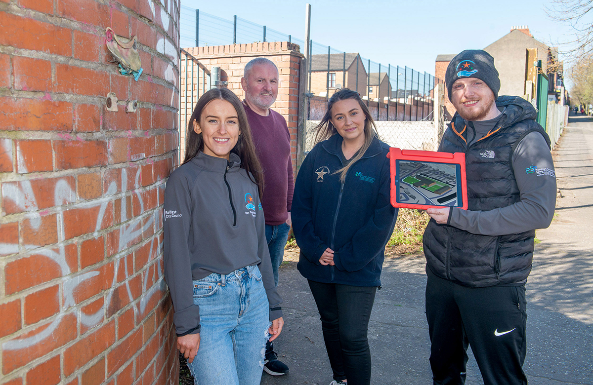 Pictured demonstrating the new app is Paul Smyth from Belfast Interface Project (back left) alongside Caitriona O'Neill, Eimear Kelly and Kevin Barry Brown from the Star Neighbourhood Centre.