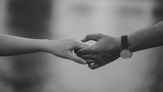 two people holding hands   CRC NI
