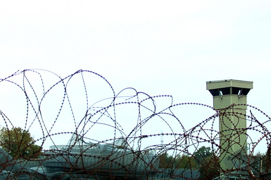 A view of barbed wire and a prison watchtower | NI CRC