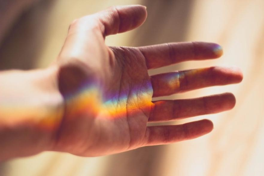 a rainbow prism of light on a hand   NICRC