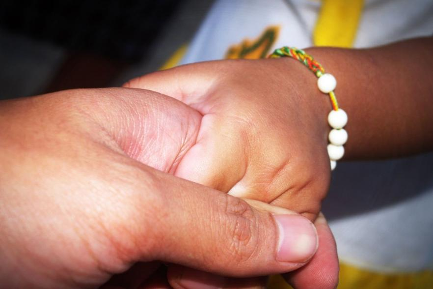 An old person holding hands with a child | CRC NI