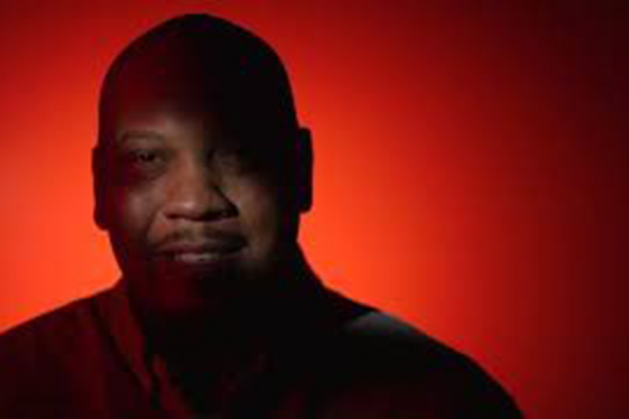 A man with a red background