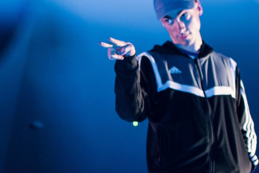 A teenager in a tracksuit on stage | CRC NI
