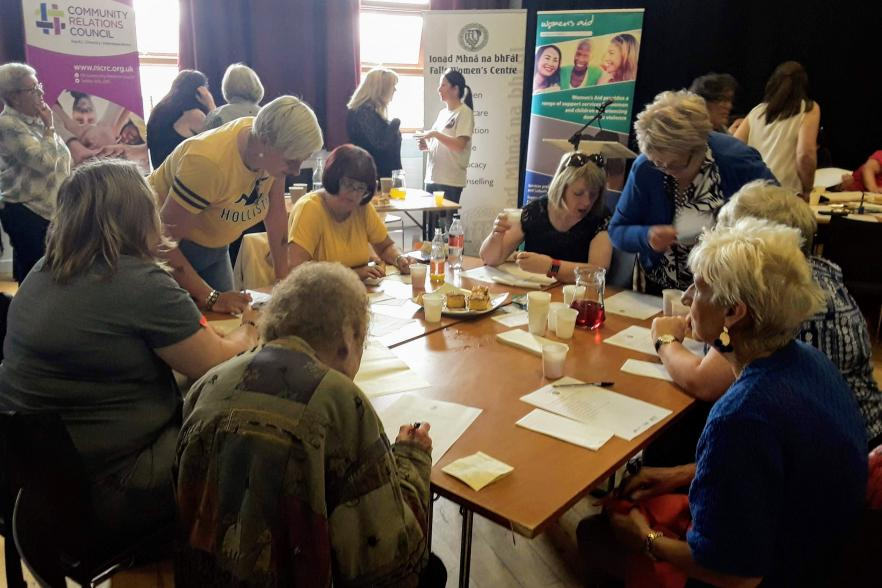People learning together at a table | CRC NI