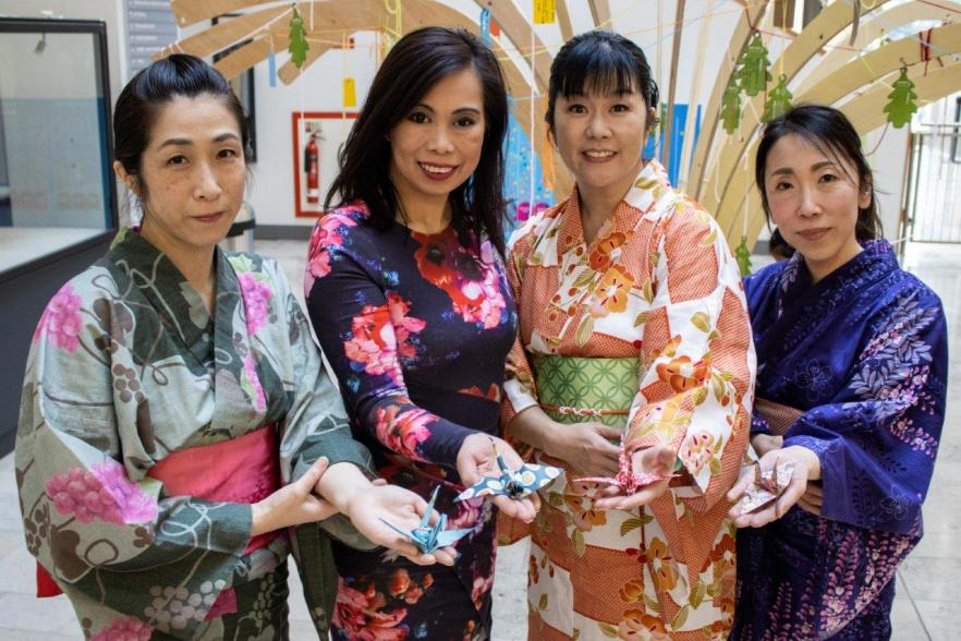 Women with paper cranes | NICRC