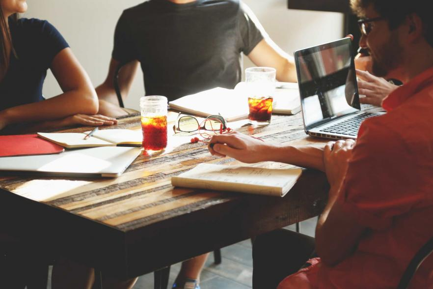 Several people working together at a table | CRC NI