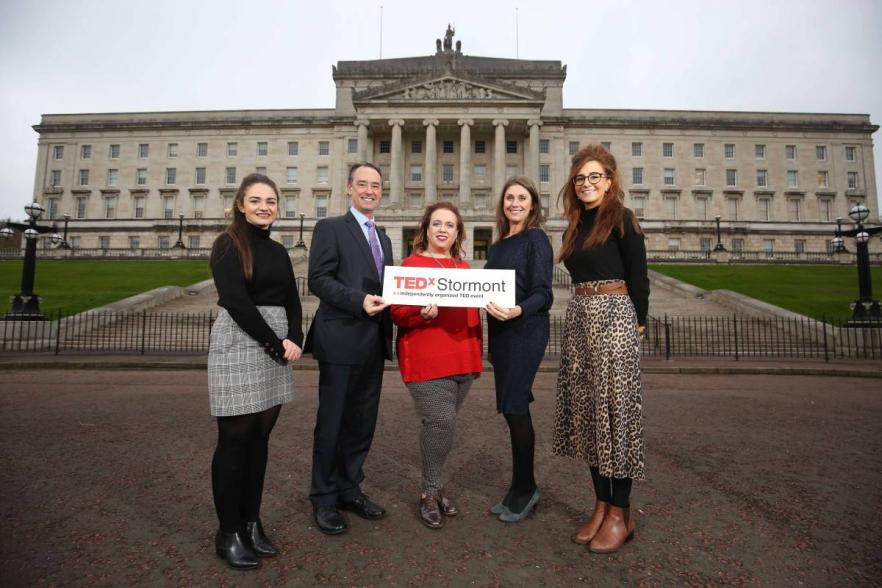 Five people outside Stormont at the TedX launch | CRC NI