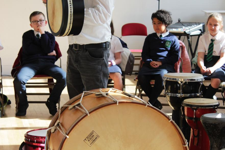 Musicians playing together with school children | CRC NI