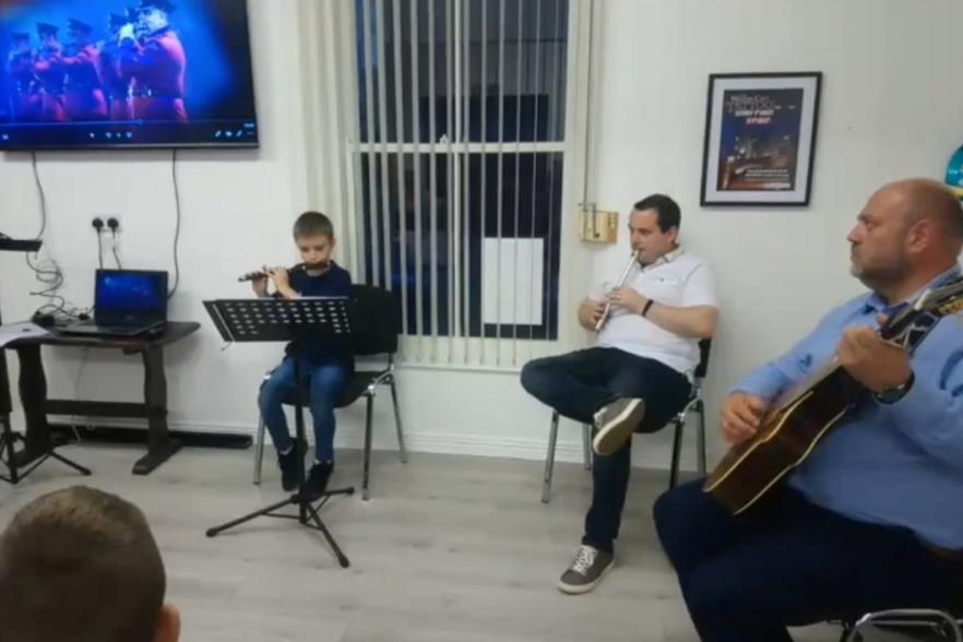 Jonathan playing with two other musicians | CRC NI