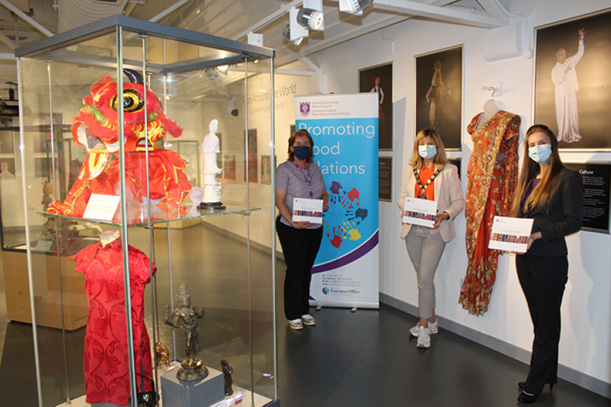 Three people at the launch of the exhibition | NICRC